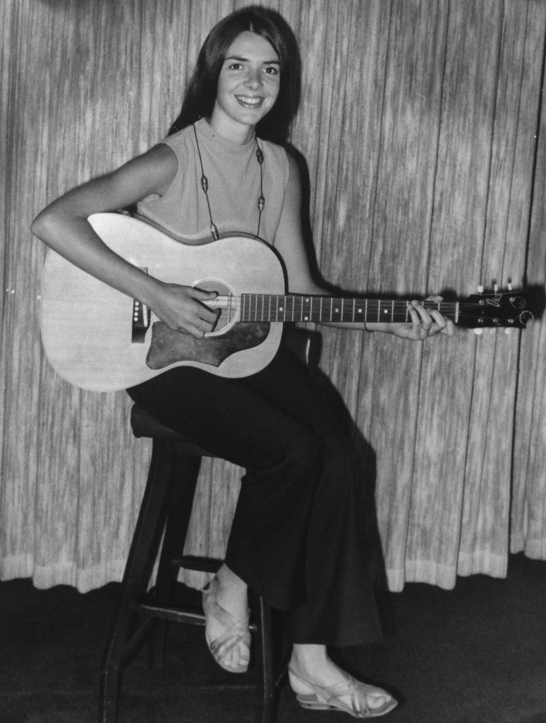 young ann with guitar